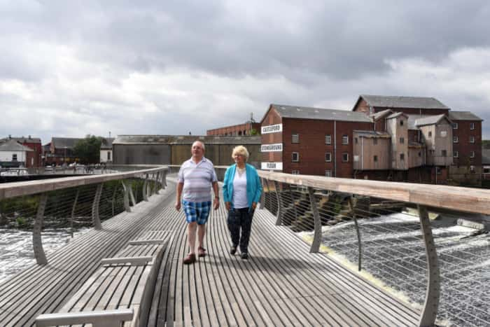 Rod Rayner and Alison Drake walk over the Millennium Bridge